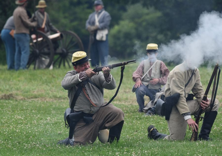 Confederate troops fire on their battlefield opponents in a portrayal of the Battle of Vicksburg during Civil War Days at Lakewood Forest Preserve near Wauconda.