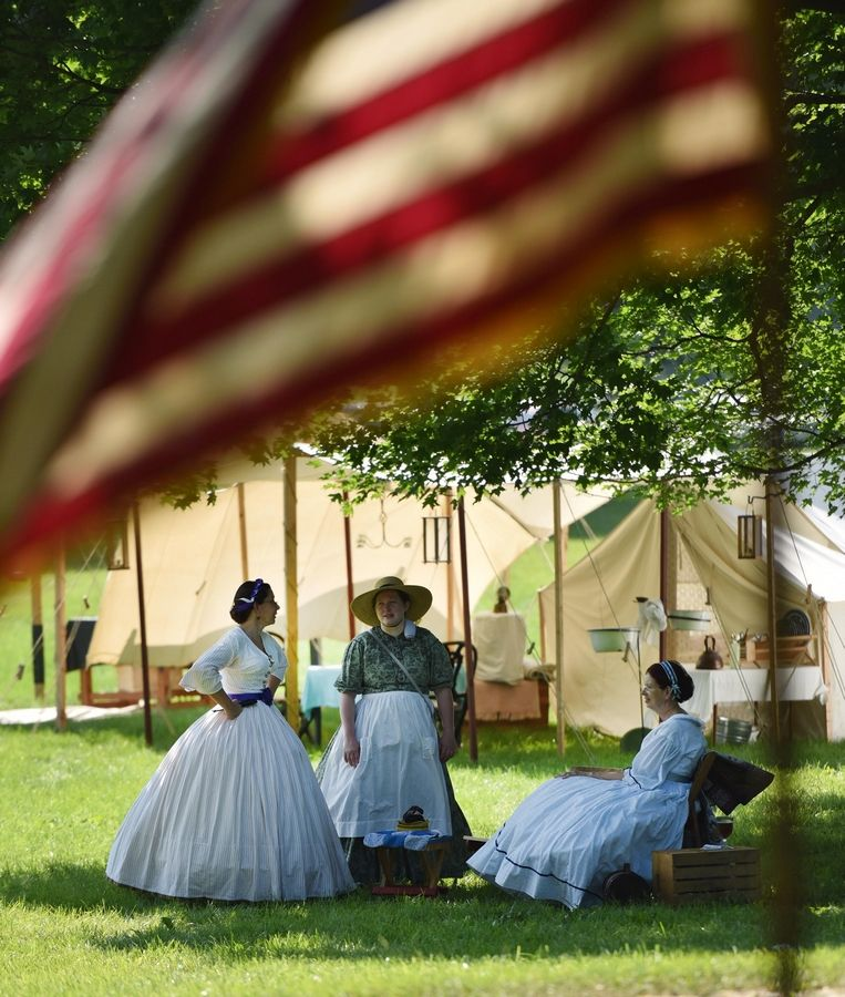 Ladies lounge during Civil War Days encampment in Lakewood Forest Preserve ear Wauconda.