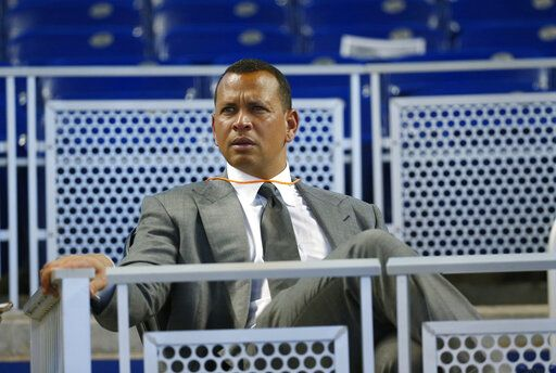 "FILE - In this June 23, 2017, file photo, former baseball player Alex Rodriguez sits in the stands before the start of a baseball game in Miami. Rodriguez said he is happy with the improvements he has made in his second year in the booth for ESPN's ""Sunday Night Baseball�, but he is looking to get better during the second half of the season."