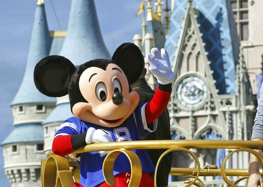 "FILE - In this Feb. 4, 2019, file photo, Mickey Mouse celebrates the Super Bowl winning team, the New England Patriots, during the Super Bowl victory parade in the Magic Kingdom at Walt Disney World in Lake Buena Vista, Fla. Months after workers who play Mickey Mouse and Goofy at Walt Disney World threatened to leave the Teamsters union because of what they called ""horrible misrepresentation,"" General President James Hoffa has appointed two associates to take over the local union in Orlando, Fla., according to a letter from Hoffa posted Monday, June 24, to the doors of the Local 385 union hall. (Joe Burbank/Orlando Sentinel via AP, File)"