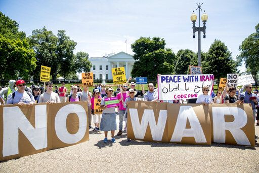 Members of the ANSWER Coalition hold an anti-war with Iran rally outside of the White House in Washington, Sunday, June 23, 2019.