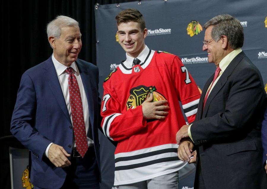 Blackhawks owner Rocky Wirtz, right, and President John McDonough welcome Kirby Dach to Chicago.