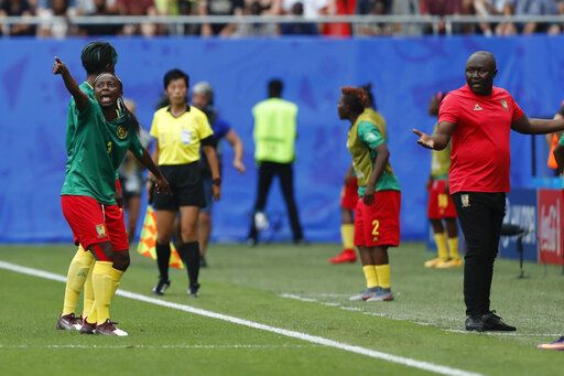 Cameroon's Ajara Nchout, left, and Cameroon head coach Alain Djeumfa react after a VAR decision that ruled out Cameroon's Ajara Nchout's goal for offside during the Women's World Cup round of 16 soccer match between England and Cameroon at the Stade du Hainaut stadium in Valenciennes, France, Sunday, June 23, 2019.