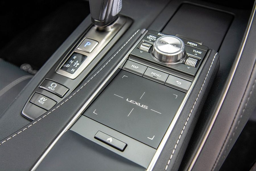 A touch pad between bucket seats interacts with the infotainment and navigation system.