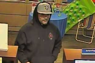 A surveillance image of a man robbing the BMO Harris Bank at 185 W. Irving Park Road in Streamwood Monday afternoon.