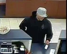 The man seen here robbing the Byline Bank at 535 Ogden Ave. in Downers Grove June 20 also is suspected of robbing BMO Harris Bank branches in Plainfield on June 17 and Streamwood on June 24.