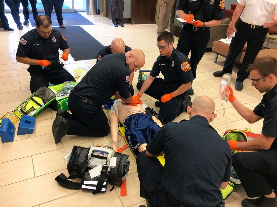 Mundelein firefighters use a computerized mannequin to simulate assisting a patient in cardiac arrest Monday at village hall.