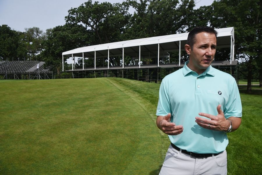 "Spectator seating and hospitality chalets already have popped up around the 18th green at Medinah for the BMW Championship in August. ""It creates a stadium-like effect on the finishing holes for the players,"" said Vince Pellegrino, the tournament director."