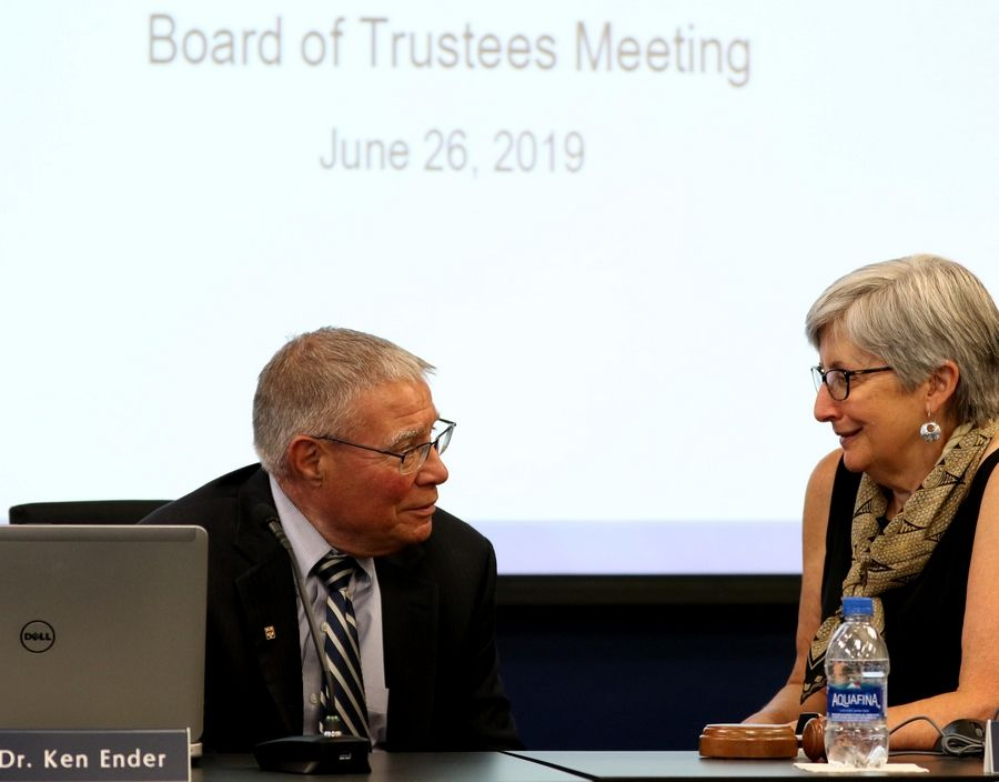 "Harper College board Chairwoman Pat Stack, right, said President Ken Ender ""exceeded expectations"" on his performance goals, leading the board to award him a $45,000 bonus as he completes his decadelong tenure at the college."
