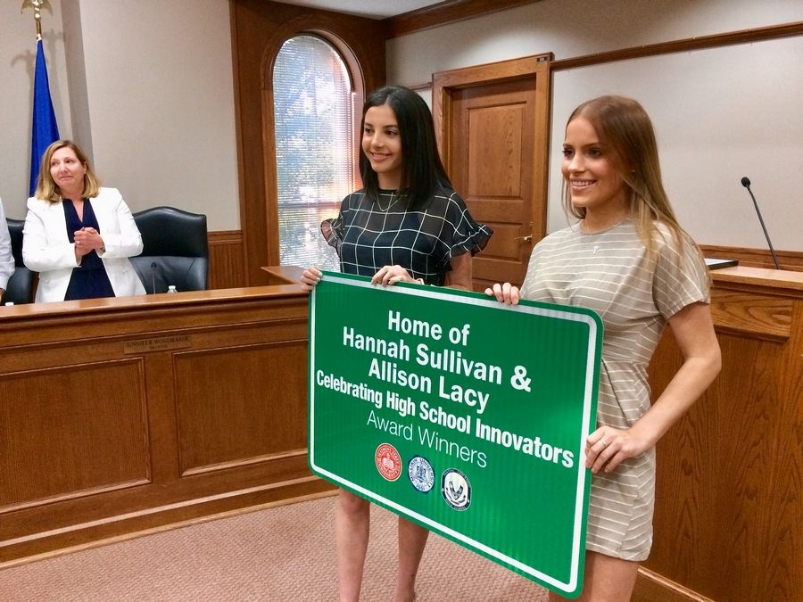 Barrington village board members this week honored Allison Lacy, left, and Hannah Sullivan for being among the state's top high school business innovators of the year.