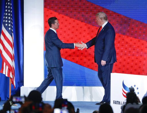 President Donald Trump, right, greets Ralph Reed, left, founder and chairman of the Faith & Freedom Coalition, before speaking at the Faith & Freedom Coalition conference in Washington, Wednesday, June 26, 2019.
