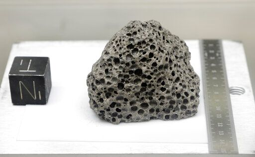 Collected during Apollo 15, a 3.5 billion years old basalt rock similar to rocks formed around Hawaii, is displayed in a pressurized nitrogen-filled examination case inside the lunar lab at the NASA Johnson Space Center Monday, June 17, 2019, in Houston. For the first time in decades, NASA is about to open some of the pristine samples and let geologists take a crack at them with 21st-century technology.