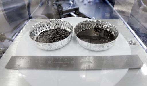Two separate 2 inch foil pans hold lunar dirt, from the last shovel full collected by Neil Armstrong on the Apollo 11, in the lunar lab at the NASA Johnson Space Center Monday, June 17, 2019, in Houston.