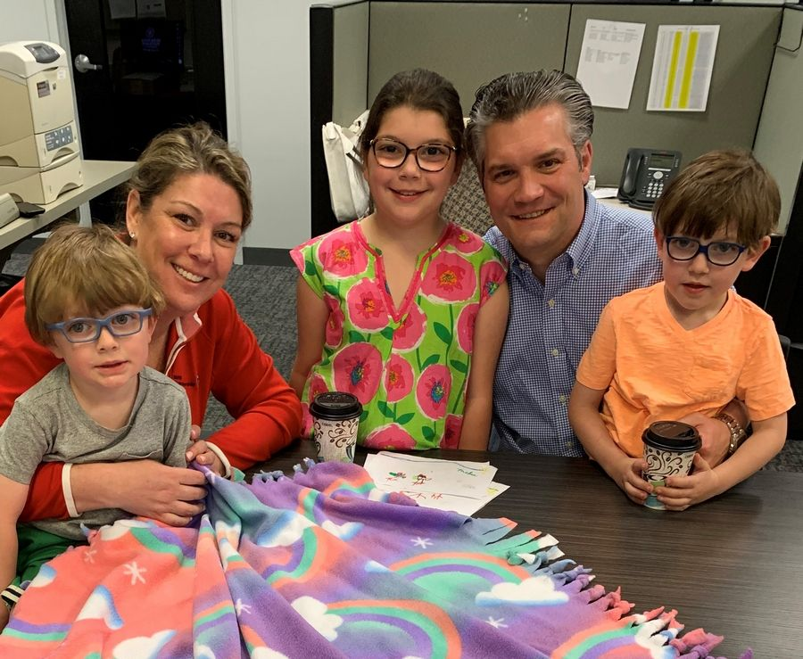 The Rynes family helps make blankets for Project Linus during the Glenview office Berkshire Hathaway HomeServices KoenigRubloff Realty Group Community Kindness event.Berkshire Hathaway HomeServices KoenigRubloff Realty Group