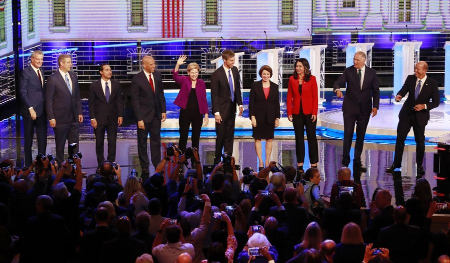 From left, New York City Mayor Bill de Blasio, Rep. Tim Ryan, D-Ohio, former Housing and Urban Development Secretary Julian Castro, Sen. Cory Booker, D-N.J., Sen. Elizabeth Warren, D-Mass., former Texas Rep. Beto O'Rourke, Sen. Amy Klobuchar, D-Minn., Rep. Tulsi Gabbard, D-Hawaii, Washington Gov. Jay Inslee, and former Maryland Rep. John Delaney Wednesday before the start of a Democratic primary debate hosted by NBC News at the Adrienne Arsht Center for the Performing Arts in Miami.