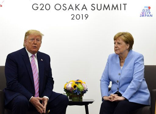 President Donald Trump meets with German Chancellor Angela Merkel on the sidelines of the G-20 summit in Osaka, Japan, Friday, June 28, 2019.