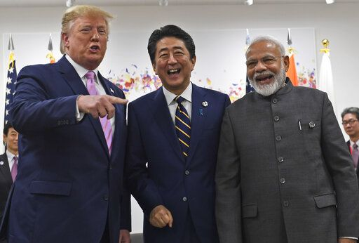 President Donald Trump meets with Japanese Prime Minister Shinzo Abe and Indian Prime Minister Narendra Modi during a meeting on the sidelines of the G-20 summit in Osaka, Japan, Friday, June 28, 2019.