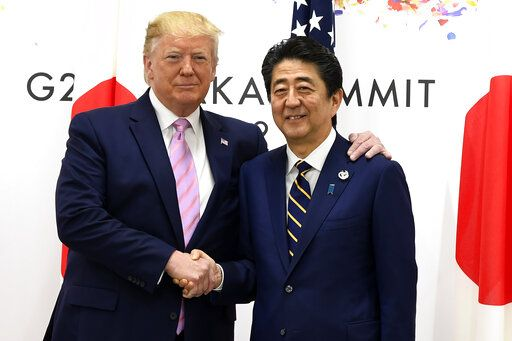 President Donald Trump meets with Japanese Prime Minister Shinzo Abe during a meeting on the sidelines of the G-20 summit in Osaka, Japan, Friday, June 28, 2019.