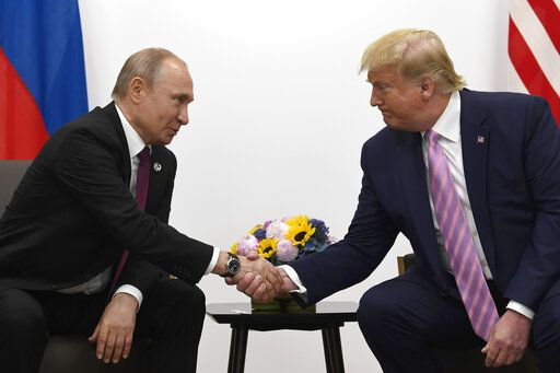 President Donald Trump, right, shakes hands with Russian President Vladimir Putin during a bilateral meeting on the sidelines of the G-20 summit in Osaka, Japan, Friday, June 28, 2019.