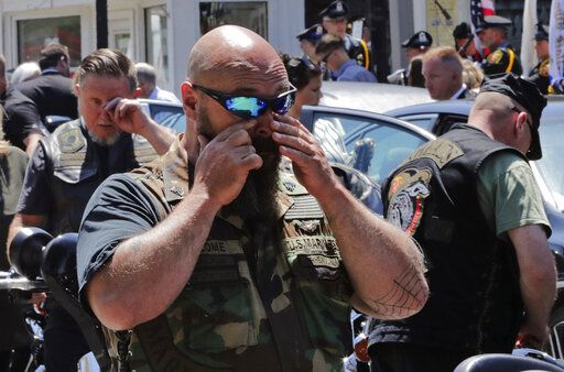 Members of the Jarheads Motorcycle Club react after the casket of Michael Ferazzi was loaded into a hearse following a funeral at St. Peter's Catholic Church in Plymouth, Mass., Friday, June 28, 2019. Ferazzi, a motorcyclist and retired police officer, was killed in a fiery crash that claimed the lives of seven people riding with the Jarheads Motorcycle Club in New Hampshire.