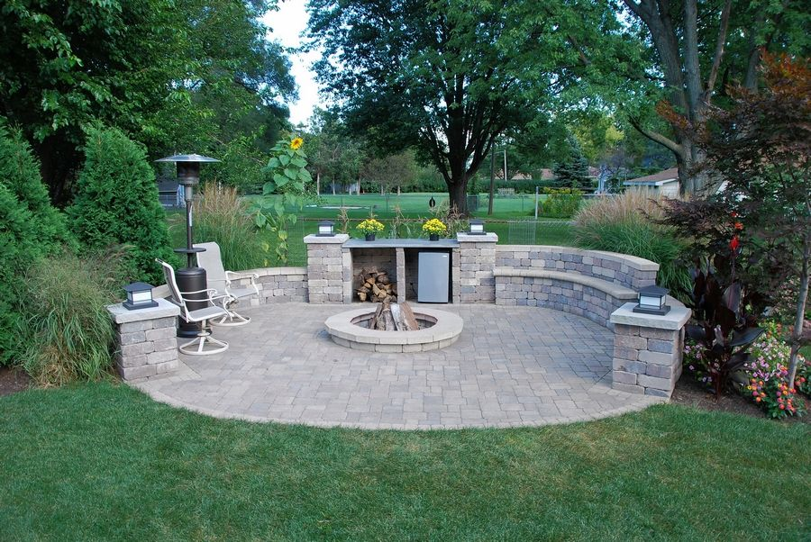 Land Escapes designs and installs paver driveways, walkways and patios, many of which have a firepit feature.