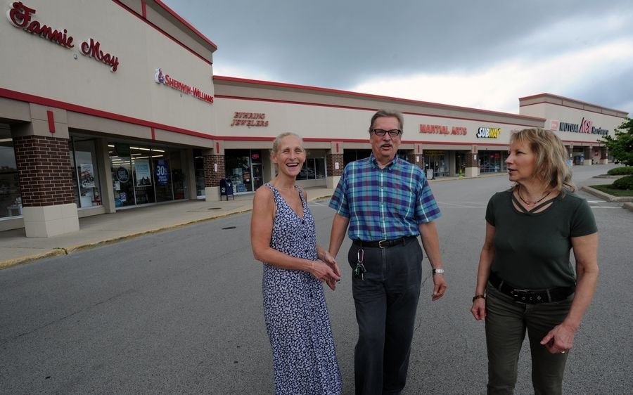 Roberta Sullivan, owner of d'Vine Wine and Gifts, along with Glenn Nelsen of Byhring Jewelers and Jan Wood, co-owner of JP Wood Martial Arts, at Palatine Plaza. The center is on the upswing for its 60th anniversary.