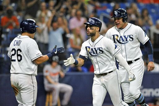 Tampa Bay Rays' Ji-Man Choi (26), Kevin Kiermaier, center, and Avisail Garcia, right, celebrate Kiermaier's three-run home run off Baltimore Orioles reliever Branden Kline during the sixth inning of a baseball game Monday, July 1, 2019, in St. Petersburg, Fla.
