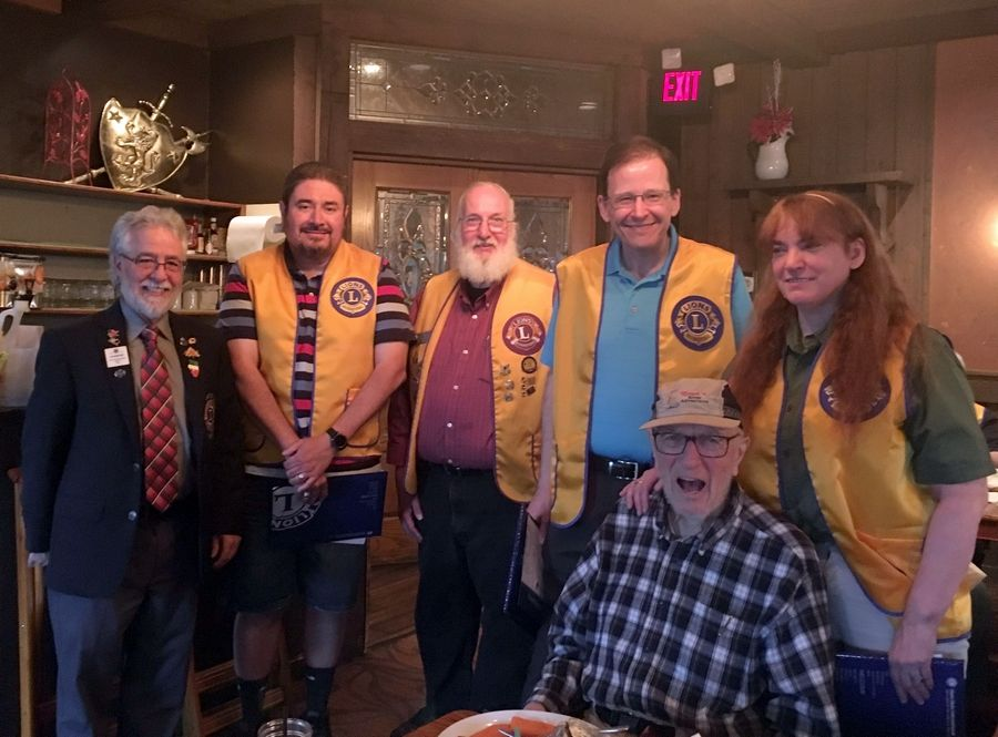 Lions Jerry Perez, left, Mike Buhrmann, center, and Herb Beck, seated, welcome three new Dundee Township Lions Club members Jaime Trevez, second from left, and John and Barbara Wadsworth.