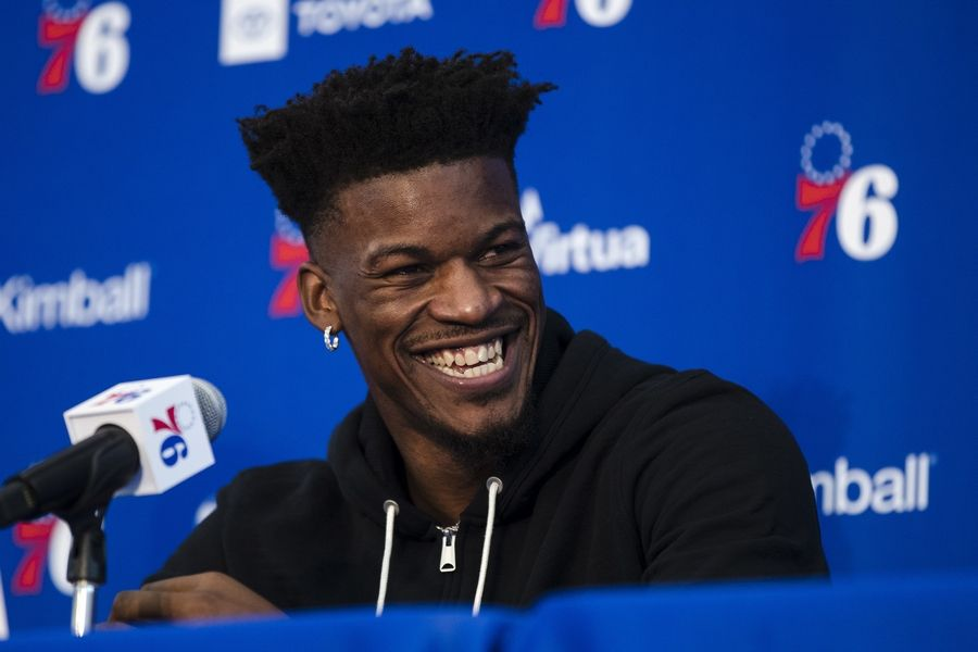 FILE - In this Nov. 13, 2018 file photo Philadelphia 76ers' Jimmy Butler speaks with members of the media during a news conference at the NBA basketball team's practice facility in Camden, N.J. There is no more doubt about Butler's future. The Miami Heat completed agreements on what will become a four-team trade Monday, July 1, 2019 to land Butler from the 76ers, with the Los Angeles Clippers and Portland Trail Blazers also involved.