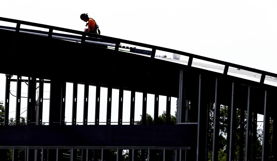 A worker atop a new building under construction in Hillsborough, North Carolina.