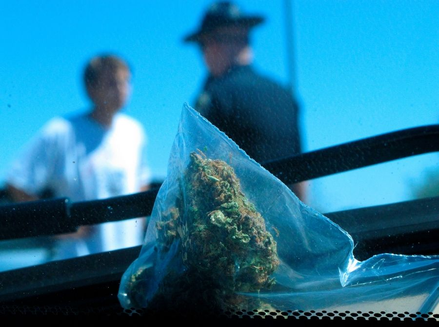 Recreational marijuana use will be legal Jan. 1, but until then, don't expect to catch a break from suburban police if you're caught possessing pot.