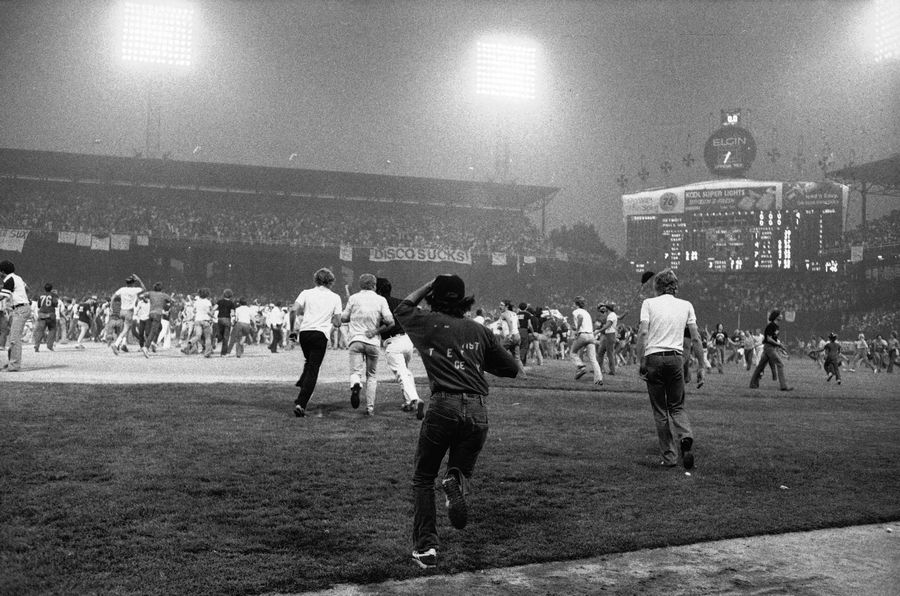 Fans storm the field at Comiskey Park on Disco Demolition Night, July 12, 1979, after the first game of a doubleheader between the White Sox and Detroit Tigers. The promotion by radio personality Steve Dahl turned into a free-for-all after hundreds of disco records were blown up on the field. The second game of the doubleheader was called by umpires who declared the field unfit for play.