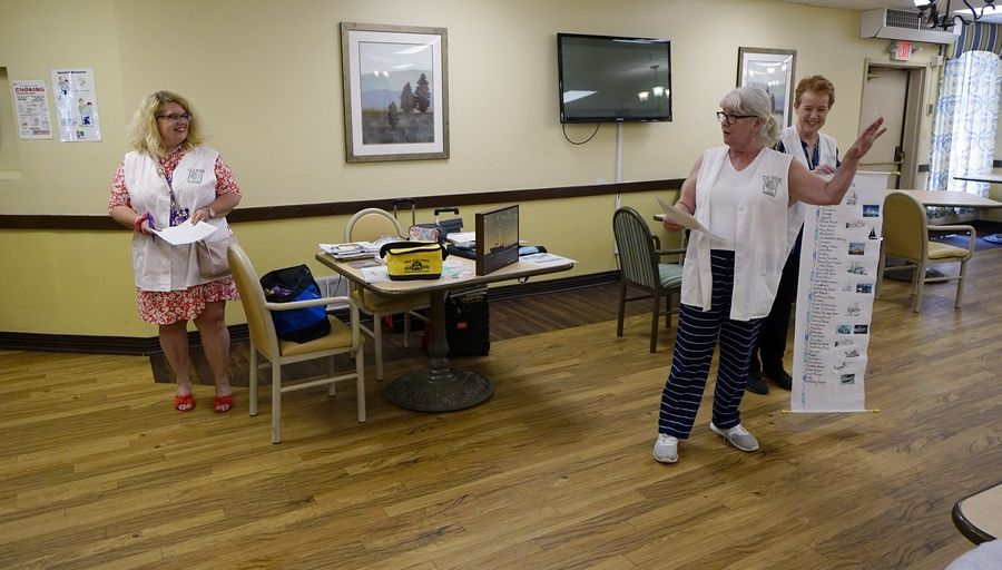 Staff member Glenna Godinsky, from left, and volunteers from the Gail Borden Public Library, Debbie Cole, of South Elgin, and Elaine Kolasa, of Elgin, brought programming last week to River View Rehab Center in Elgin.