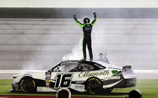 Ross Chastain celebrates on top of his car in front of fans after winning the NASCAR Xfinity Series auto race at Daytona International Speedway, Saturday, July 6, 2019, in Daytona Beach, Fla.