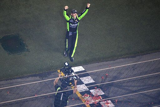 Ross Chastain celebrates after smashing a watermelon at the finish line following his win in the NASCAR Xfinity Series auto race at Daytona International Speedway, Saturday, July 6, 2019, in Daytona Beach, Fla.