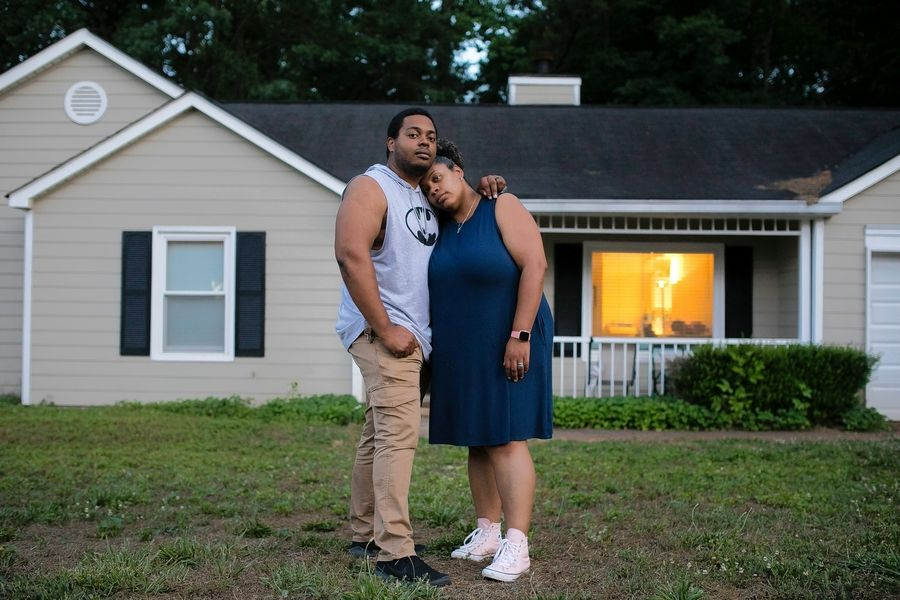 Carl Dunlap and Sommer Johnson are pictured in May at the home they rent in Douglasville, Georgia.