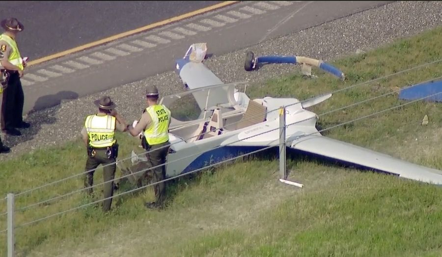Illinois State Police respond to the scene of a small plane crash Monday on I-88 near Kaneville.