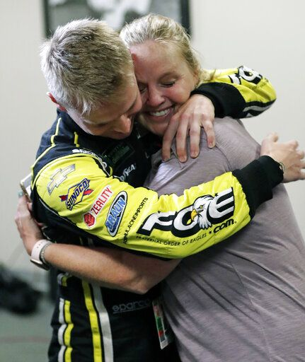 Justin Haley, left, gets a hug from his mother after he was declared the winner in a rain-shortened NASCAR Cup Series auto race at Daytona International Speedway, Sunday, July 7, 2019, in Daytona Beach, Fla.