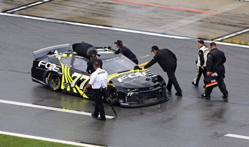 Justin Haley pushes his car off pit road after a NASCAR Cup Series auto race was stopped because of rain at Daytona International Speedway, Sunday, July 7, 2019, in Daytona Beach, Fla. Haley was declared the winner a short time later.