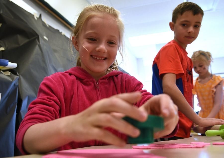 Nina Kamarauli and her fellow ART with FUNctionality classmates made some clay objects Tuesday before decorating aprons during the Hawthorn Elementary District 73's Hawthorn Enrichment Institute session at Townline School in Vernon Hills.