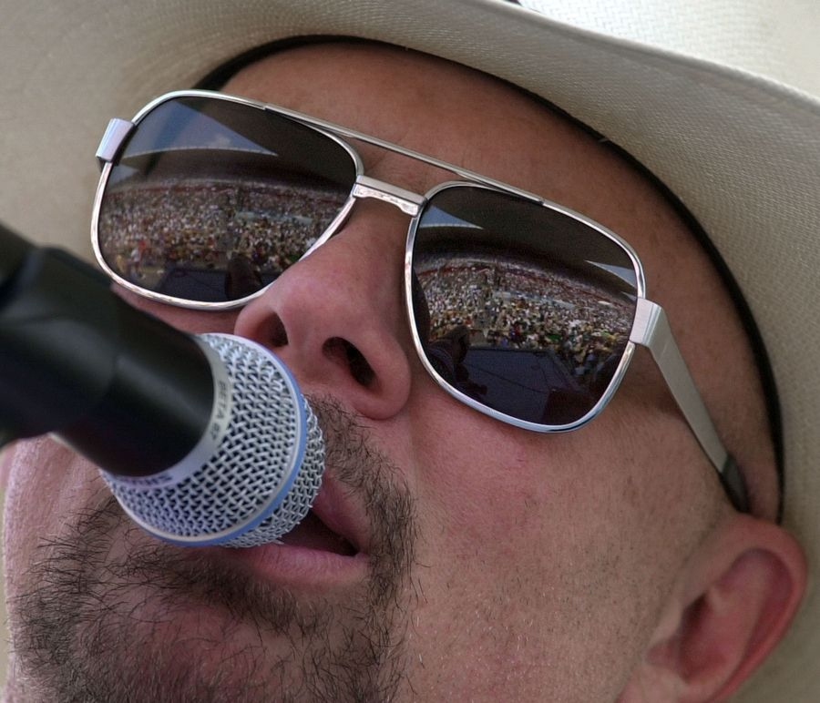 Country music fans are reflected in the glasses of Danny Shirley, lead singer for Confederate Railroad, during a 2000 concert in Nashville, Tennessee.