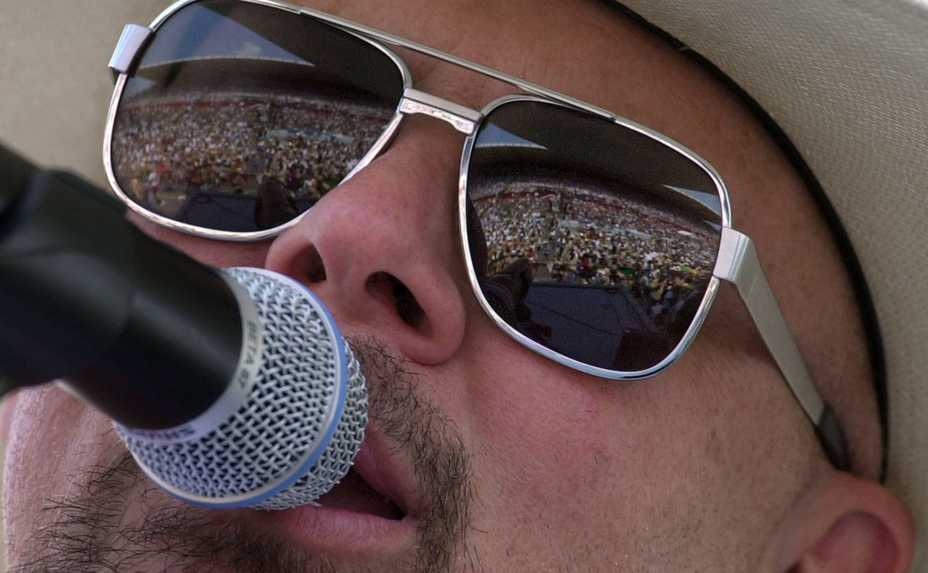 c05252ac0180 Country music fans are reflected in the glasses of Danny Shirley, lead  singer for Confederate. This Daily Herald ...