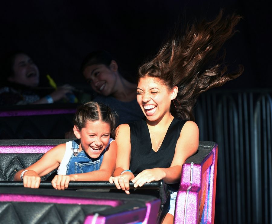 Analia Zapata, 9, and Isabelle Medina, both of Glendale Heights, ride the Matterhorn on Wednesday during the Glendale Heights Fest in Camera Park.