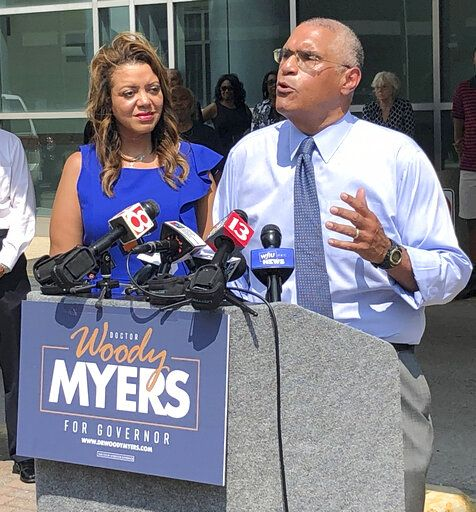 Business executive Woody Myers, right, speaks during a Wednesday, July 10, 2019, news conference in Indianapolis, announcing his candidacy for the Democratic nomination for Indiana governor for the 2020 election. Standing with Myers is his wife, Stacy.