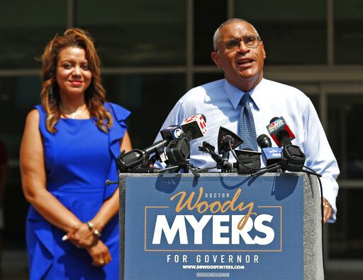 Business executive Woody Myers announces his bid for governor at the old Wishard Emergency Department where he once worked as a doctor Wednesday, July 10, 2019, in Indianapolis. His wife Stacy Myers, left, stands by his side. The Democrat is launching a campaign aimed at unseating Republican Eric Holcomb from the Indiana governor's office next year. (Kelly Wilkinson/The Indianapolis Star via AP)