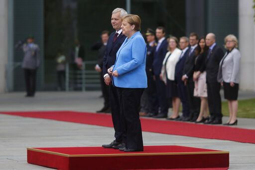 German Chancellor Angela Merkel and Prime Minister of Finland Antti Rinne listen to the national anthems at the chancellery in Berlin, Germany, Wednesday, July 10, 2019. Merkel's body shook visibly as she stood alongside the Finnish prime minister and listen to the national anthems during the welcoming ceremony at the chancellery.
