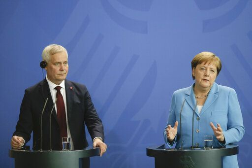 German Chancellor Angela Merkel, right, and the Prime Minister of Finland Antti Rinne brief the media after a meeting at the chancellery in Berlin, Wednesday, July 10, 2019.