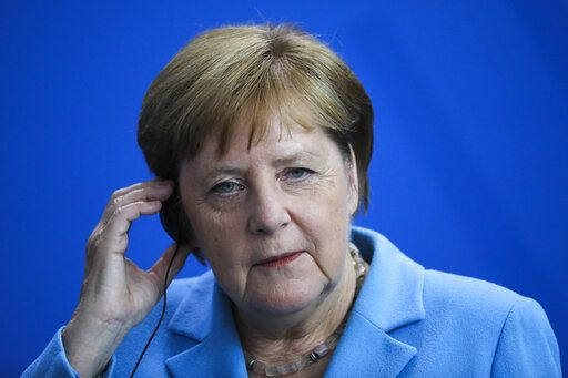 German Chancellor Angela Merkel listens to questions during a news conference following a meeting with the Prime Minister of Finland Antti Rinne at the chancellery in Berlin, Wednesday, July 10, 2019.