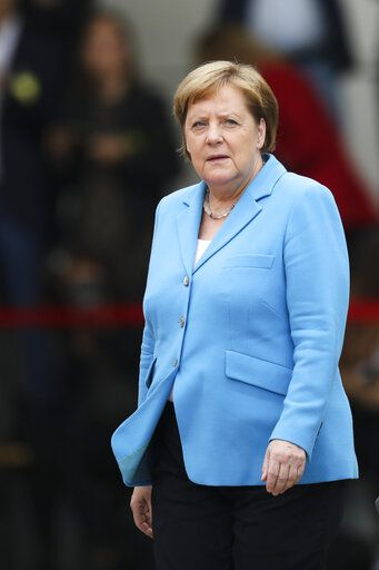German Chancellor Angela Merkel waits for the arrival of the Prime Minister of Finland Antti Rinne for talks at the chancellery in Berlin, Wednesday, July 10, 2019.