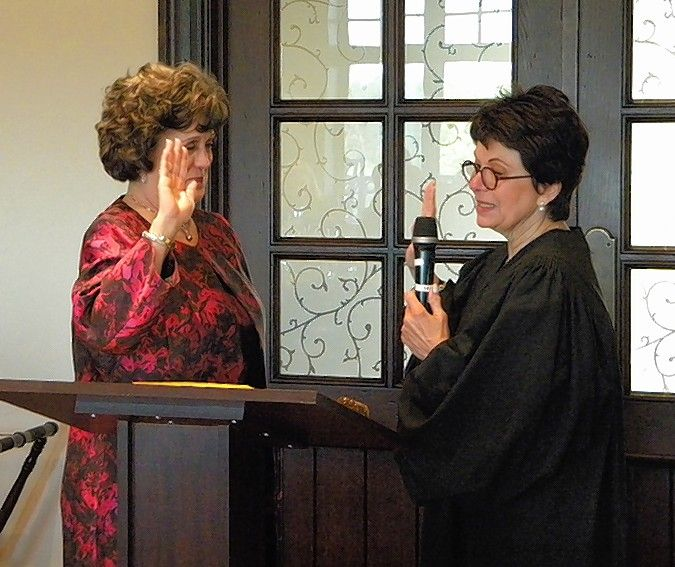 The Honorable Pamela Loza, right, swears in attorney Miriam Cooper as president of the Northwest Suburban Bar Association.